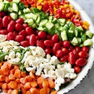 salad with carrots, cauliflower, tomatoes, cucumbers and peppers in rows