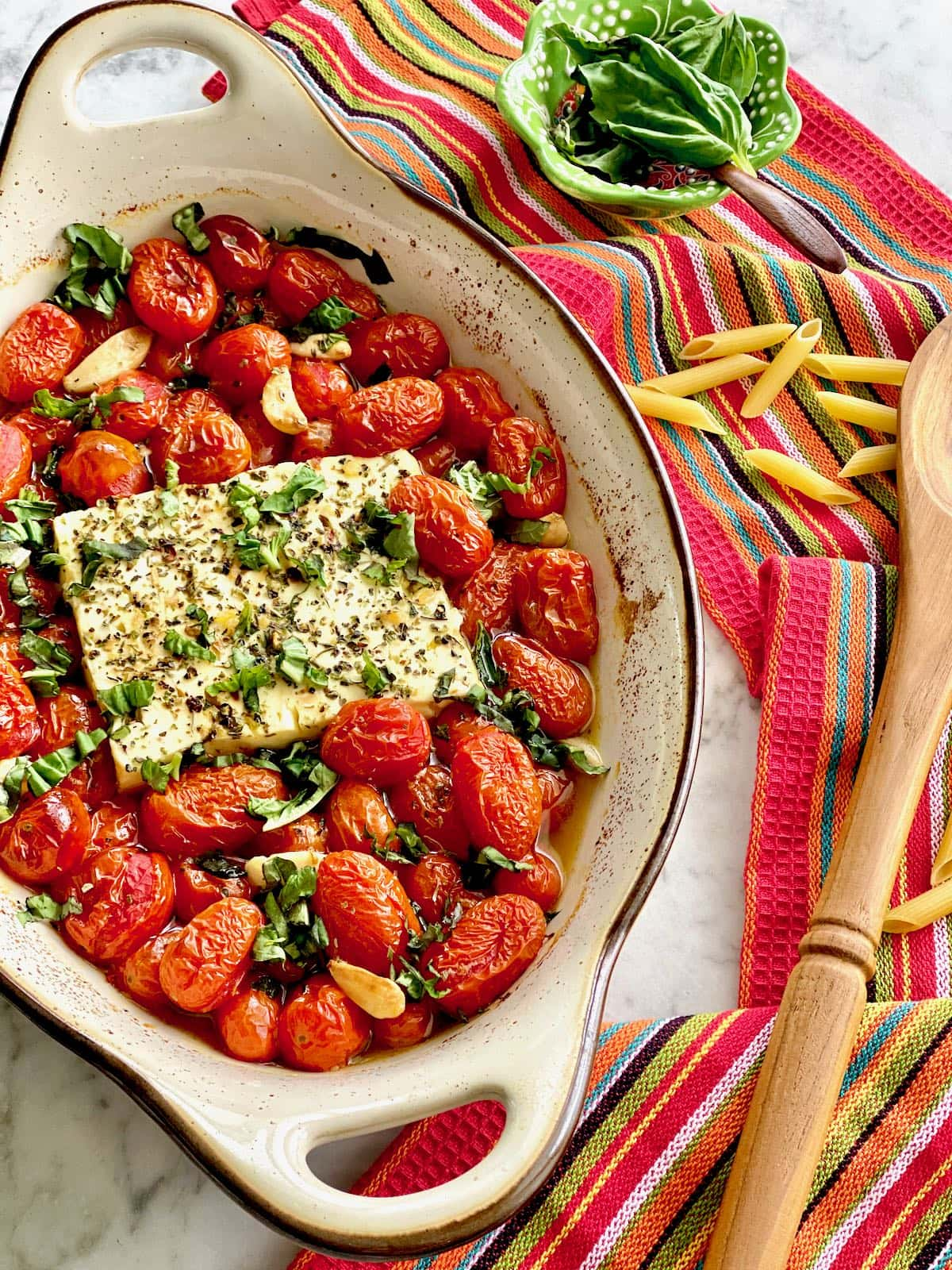 baked feta and tomatoes coming out of the oven.