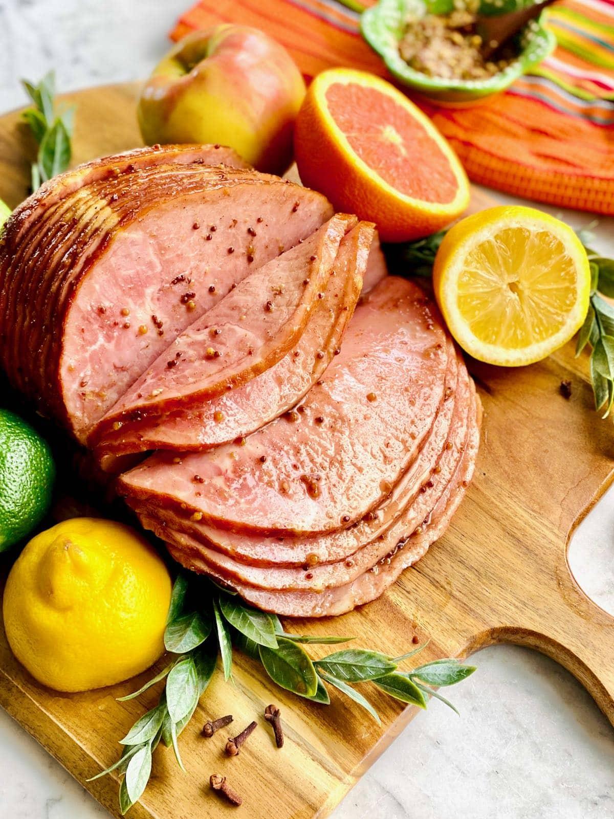 spiral ham sliced on a wooden board.