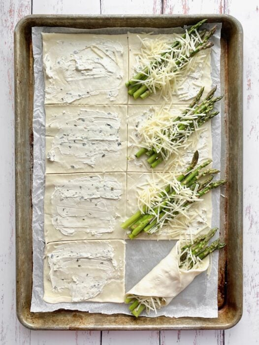 wrapping the asparagus bundles in cream cheese spread.