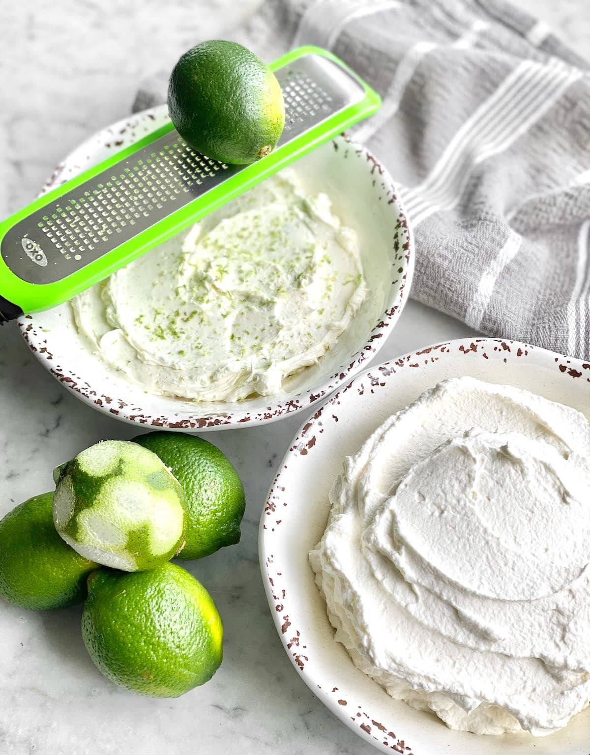 zesting limes into the cream cheese mixture.