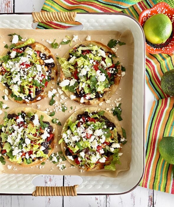 tortillas loaded with black beans, lettuce, tomatoes, chicken and feta.