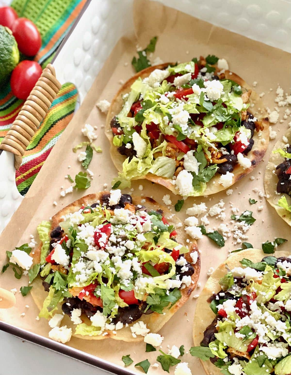 corn tortillas smothered in toppings.