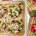 four chicken tostadas on a tray.