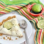 slice of pie surrounded by limes and a 'choose joy' spoon.