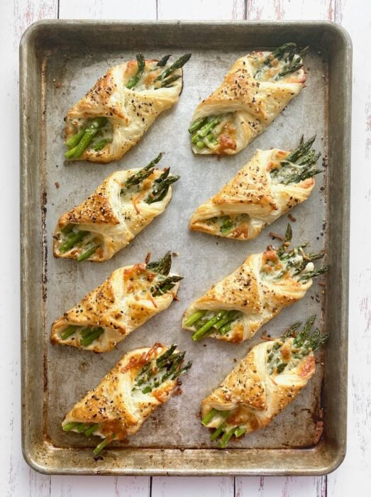 puff pastry asparagus after being baked on a sheet pan.