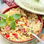 southern macaroni salad with tomatoes, cheese and celery
