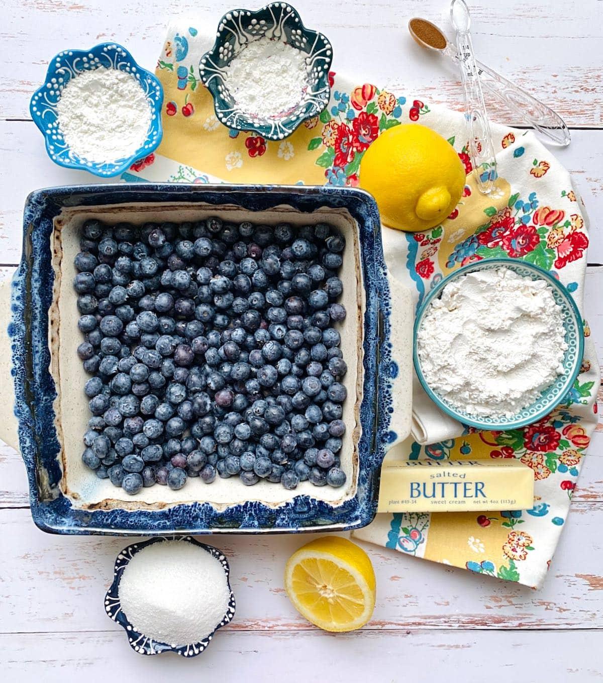 ingredients needed to make blueberry lemon crumble dessert.