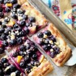 blueberry lemon pastry being served on a sheet pan.