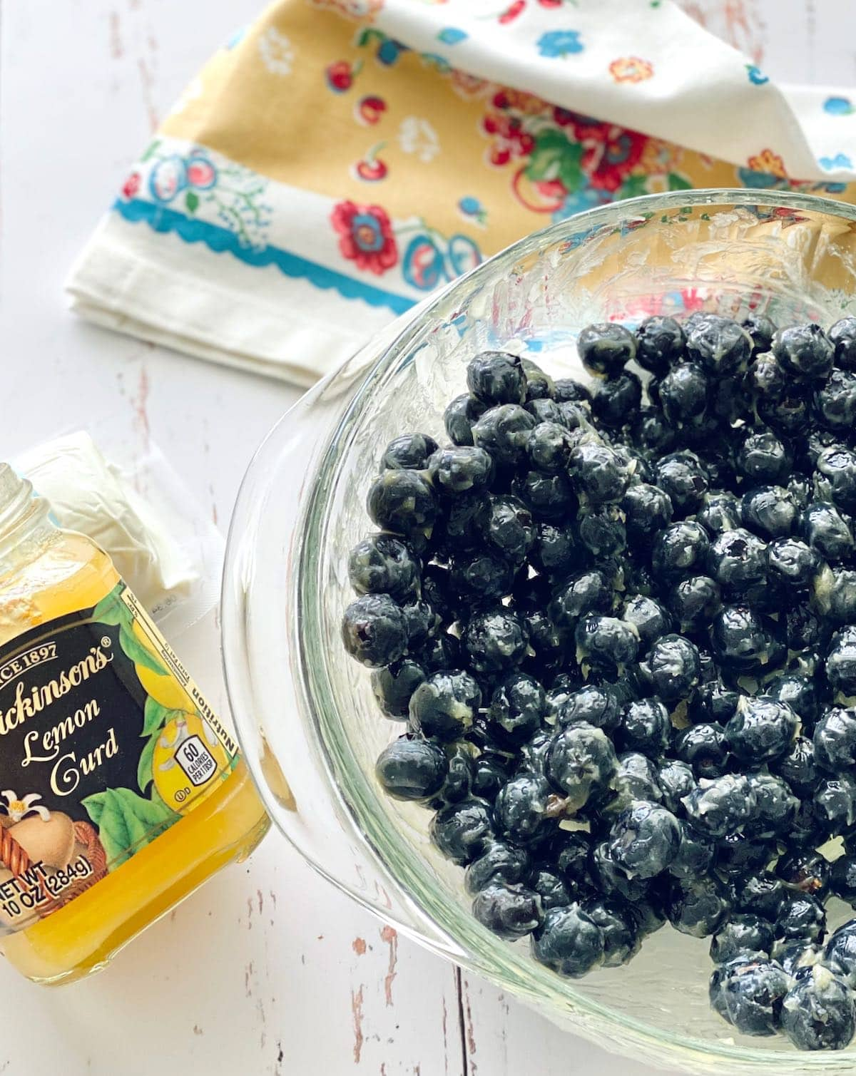 bowl of blueberries with lemon curd.