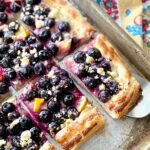 slice of blueberry lemon pastry served with a cake server.