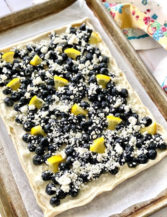 blueeberries, goat cheese and lemon on top of puff pastry.