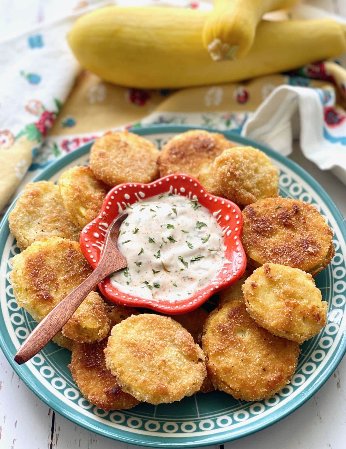 rounds of squash patties with ranch dip in the middle.