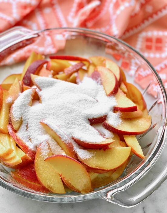 sliced peaches with sugar on top.