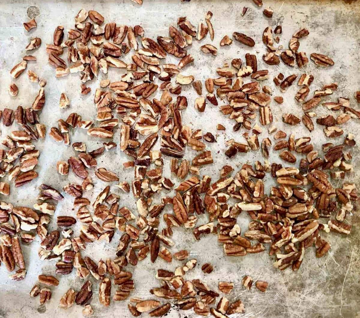 toasted pecans on a sheet pan.