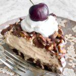 slice of frozen mocha latte pie with a fudge brownie crust.