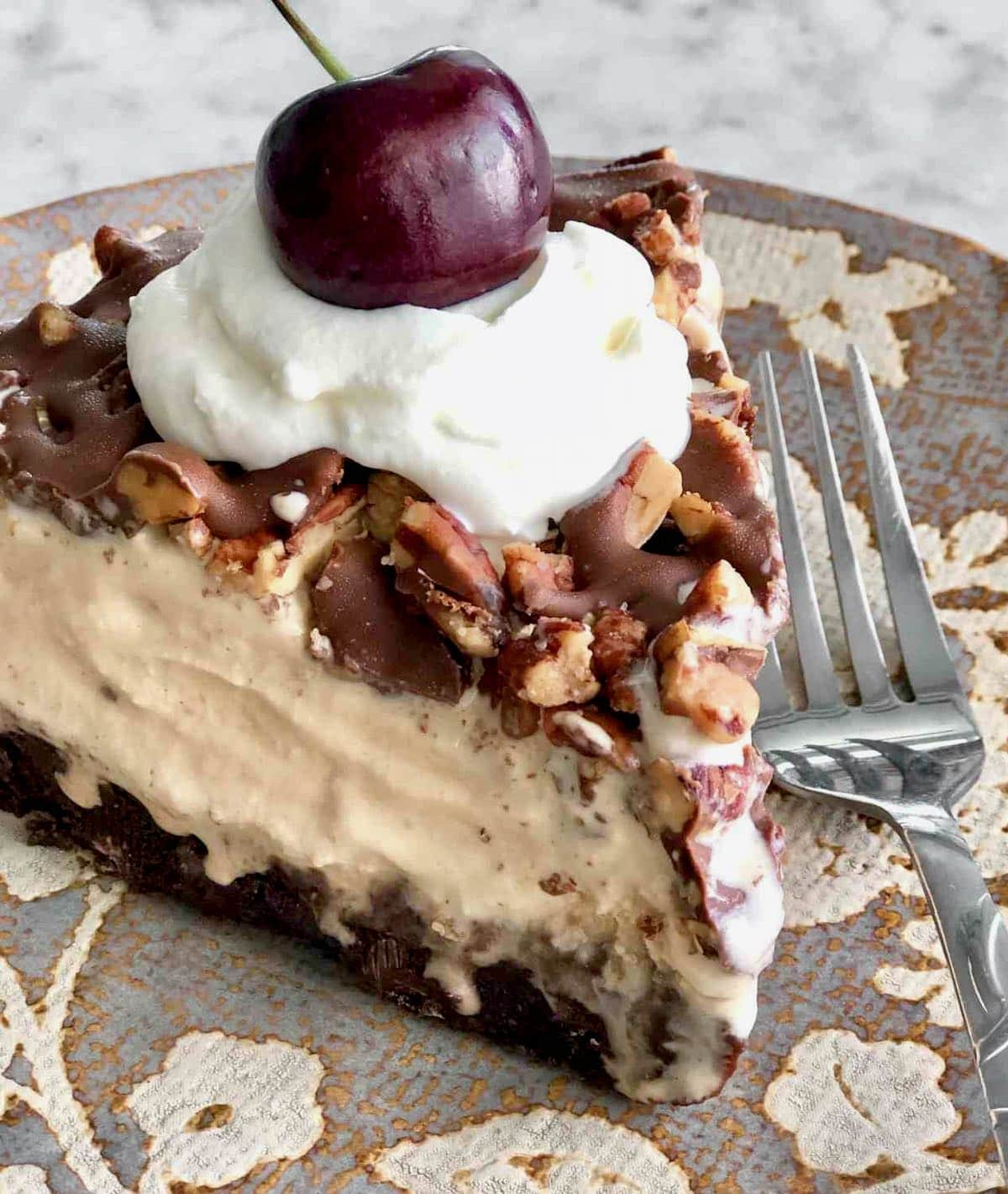 close up view of a slice of frozen mocha ice cream pie.