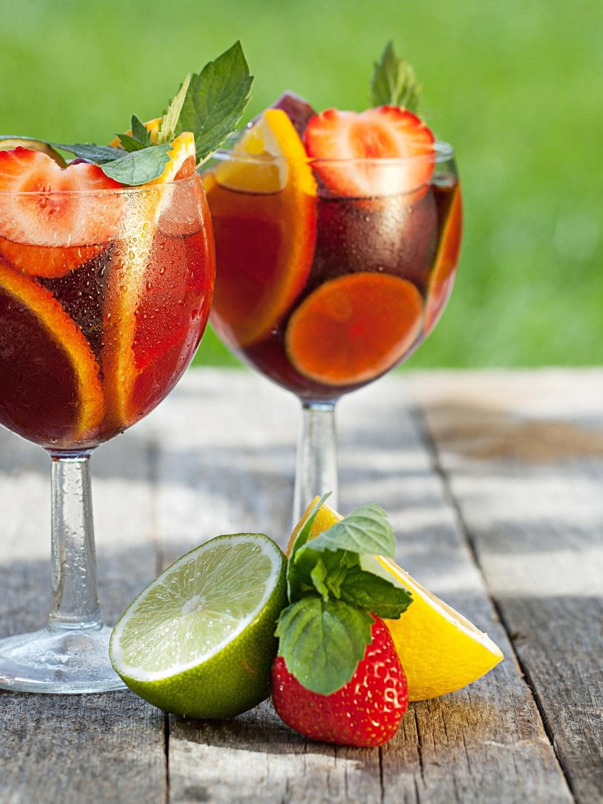 two wine glasses filled with strawberry orange sangria.