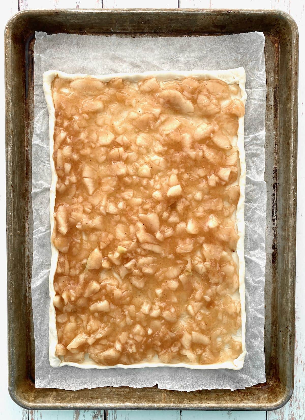apple filling spread on top of puff pastry.