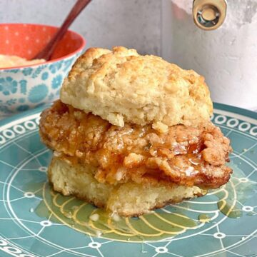close up photo of a honey butter chicken biscuit.