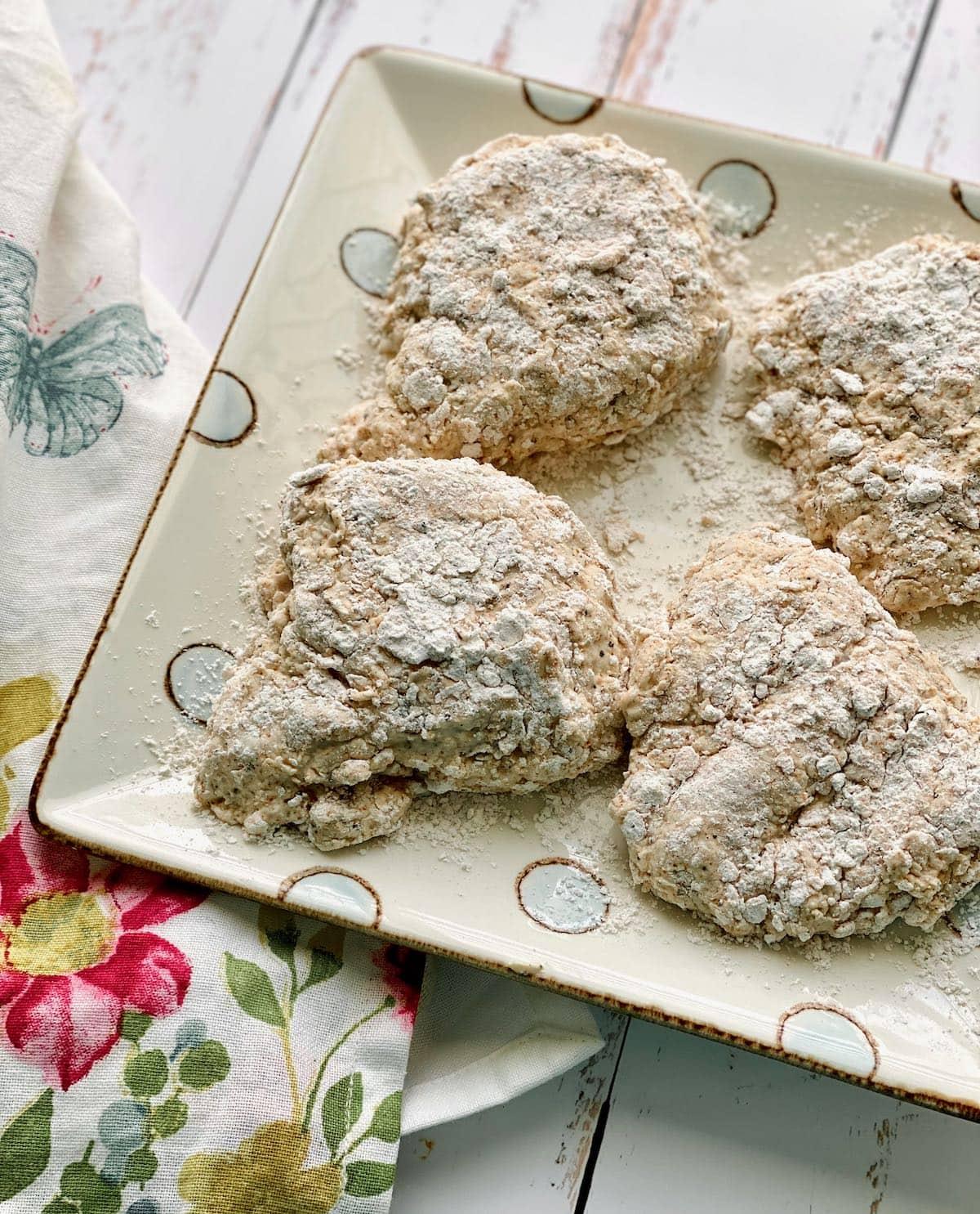 chicken breasts dredged in buttermilk and flour.
