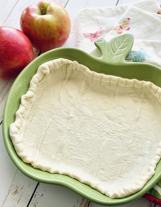 puff pastry with edges rolled down in apple dish