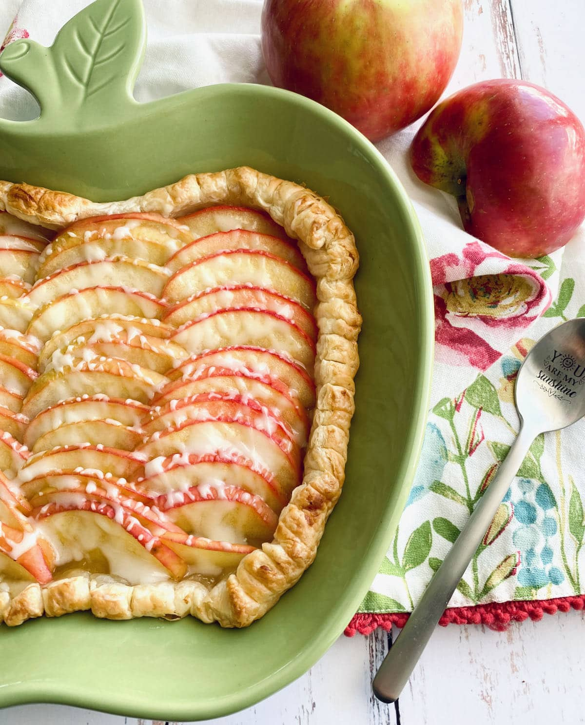 apple shaped dish with drizzled lemon curd icing