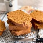 pumpkin spice latte bread stacked on a cooling rack.