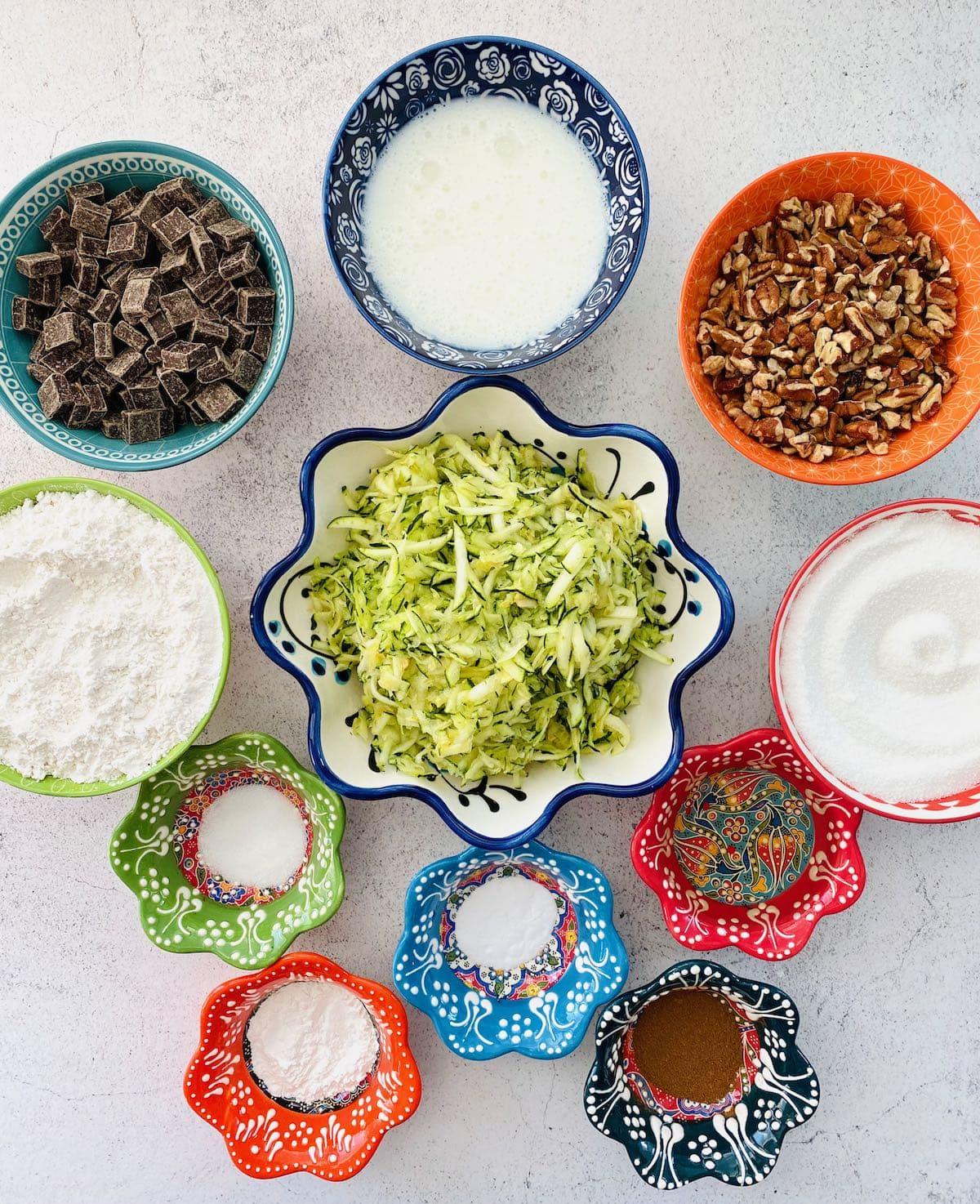 ingredients needed to make zucchini chocolate chip muffins.