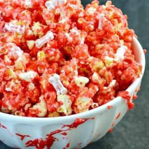 popcorn with red coloring made to look like blood with bones in it.