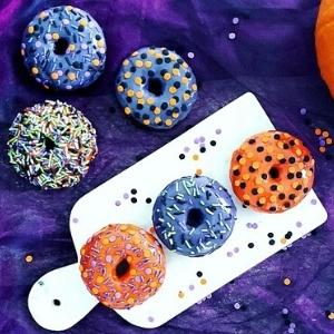 colorful donuts on a purple background.