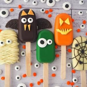 cake sickles that look like monsters in bright colors for halloween.