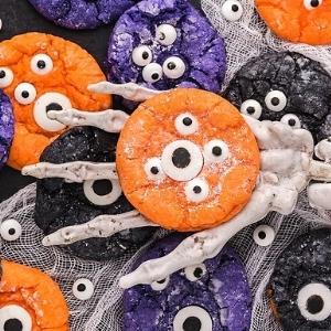 crinkle cookies that look like monsters in a skeleton hand.
