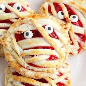 cherry hand pies made to look like mummies for halloween.