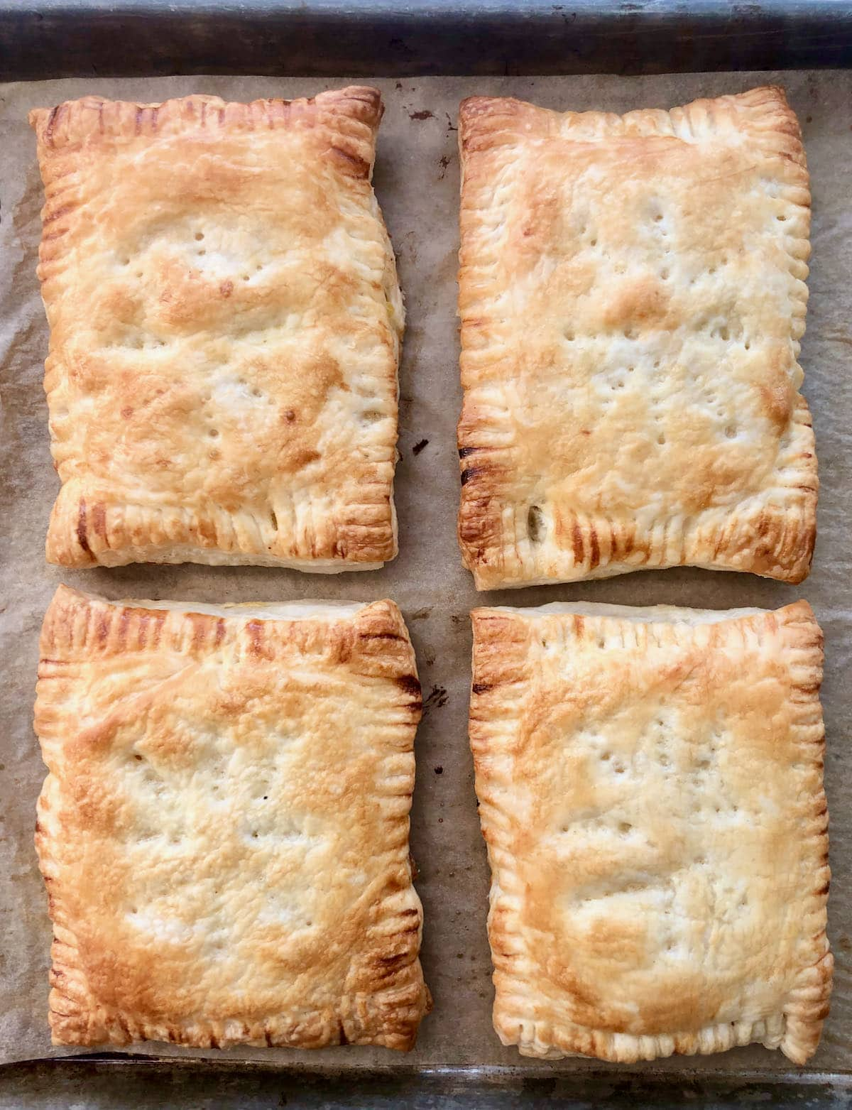 four chicken pot hand pies after being baked.