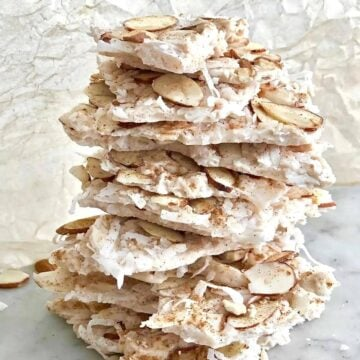 pumpkin spice coconut bark stacked high on a counter.